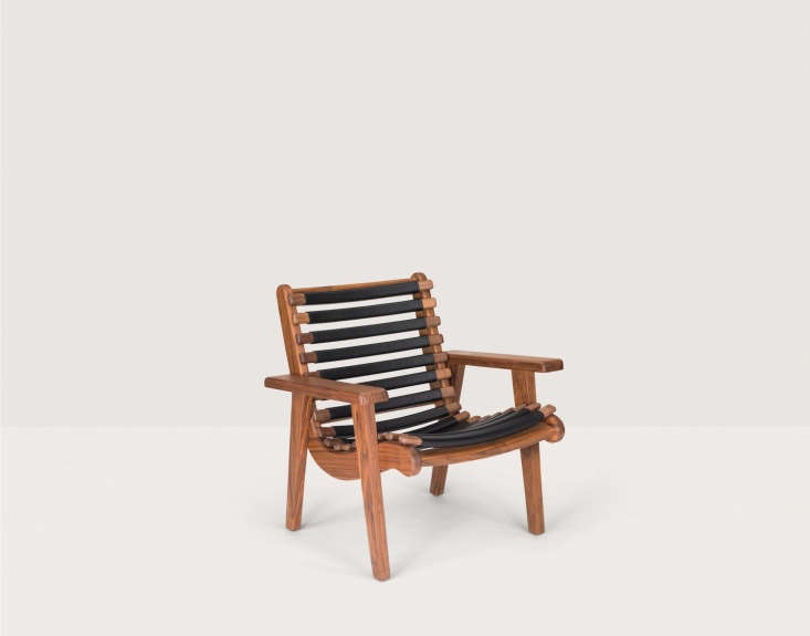 Mexican Bauhaus Wood and Leather Furniture from a Midcentury Master Reborn The armchair with black leather wrapped ribs.