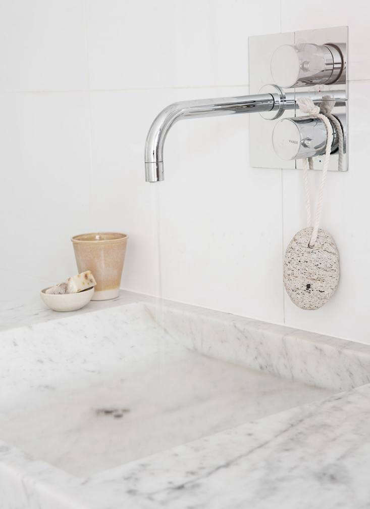 The custom sinks were fabricated locally from -centimeter-thick (3.9-inch-thick) solid marble.
