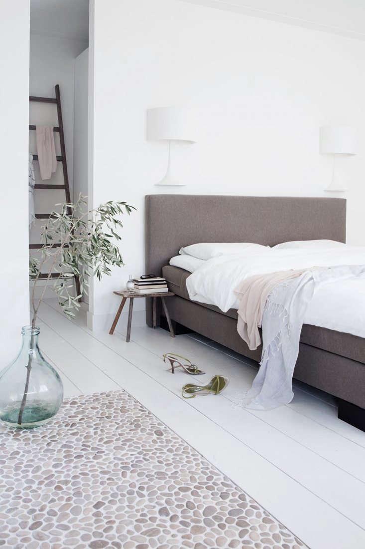 The attic master bedroom has an en suite bath with a pebble floor. &#8