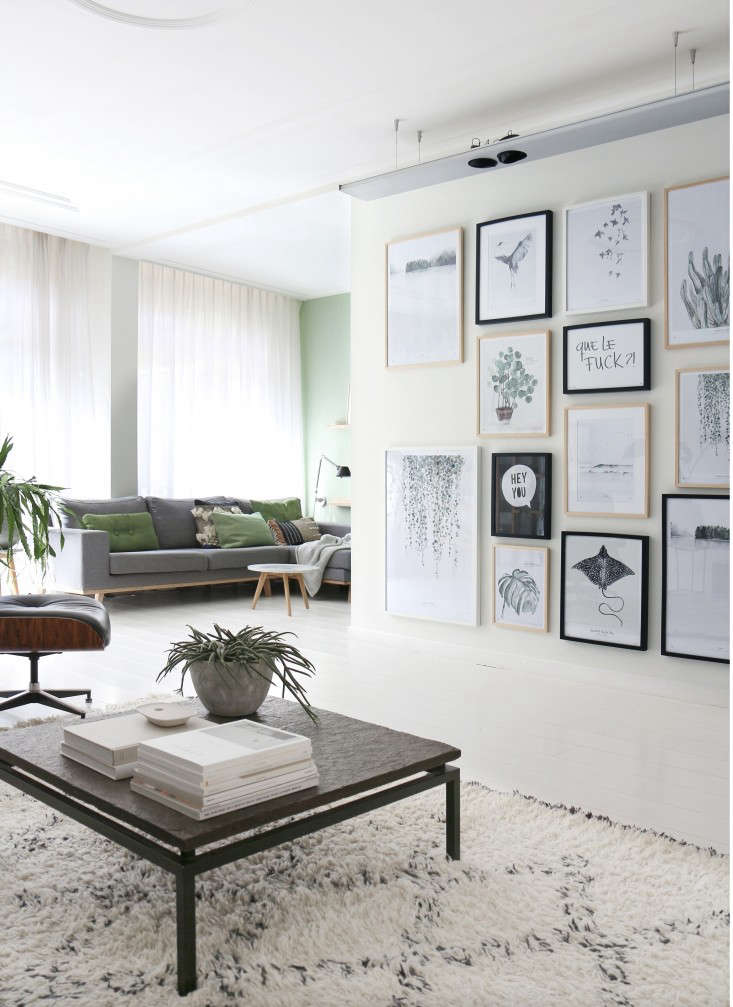 A discreet corner of the living room is the used as the TV room. The print wall displays an array of Koster&#8