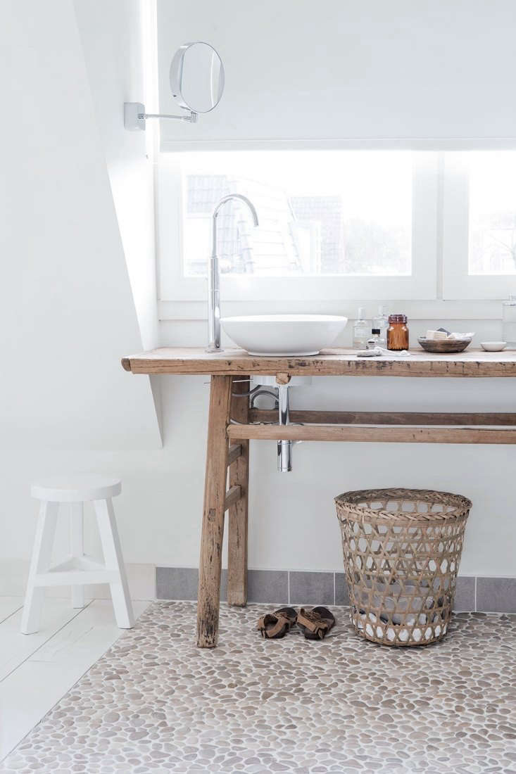 Koster used old wooden table as the base for twin countertop basins from Villeroy & Bosch.