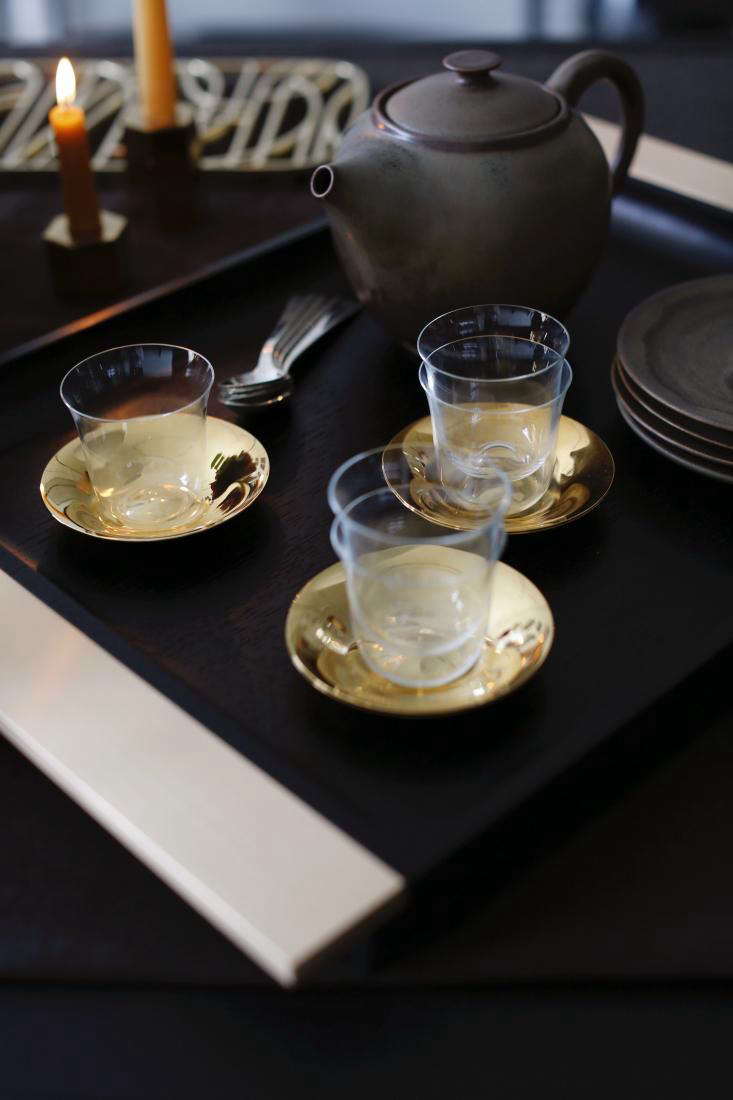For coffee service after the main course: Lobmeyr Espresso Cups ($55 each) with plated brass Saucers ($5 each) on a Black Oak Serving Tray by Belgian designerMichaël Verheyden ($3,400). ASpruce Crystallized Teapot ($900) and Spruce Crystallized Dessert Plates ($5), both byChristiane Perrochon, stand at the ready.
