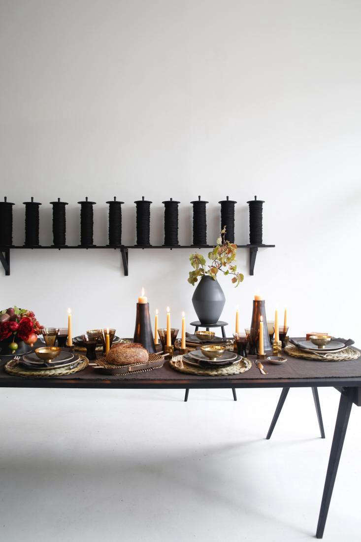 The tablescape is set on a foldedBoxwood Linen Fringed Tablecloth in the color &#8