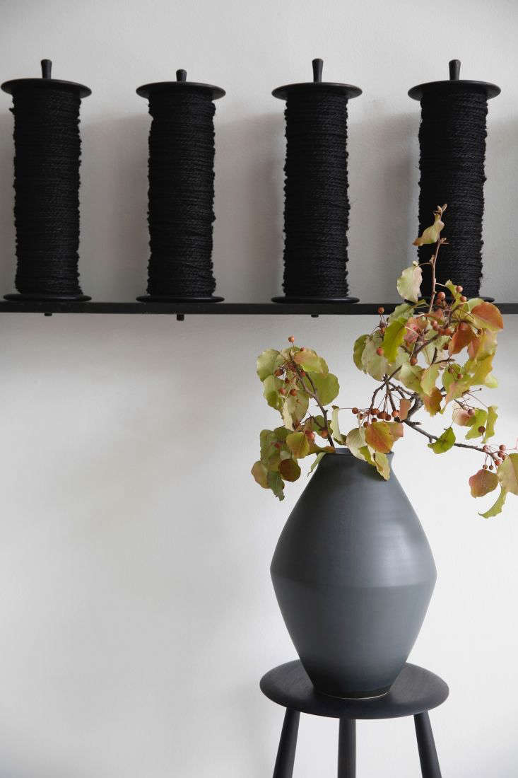 Florals need not be fancy, even in an heirloom-quality vase: Here, a simple branch clipped from the yard rests in a slate Flower Vase by Christiane Perrochon; $
