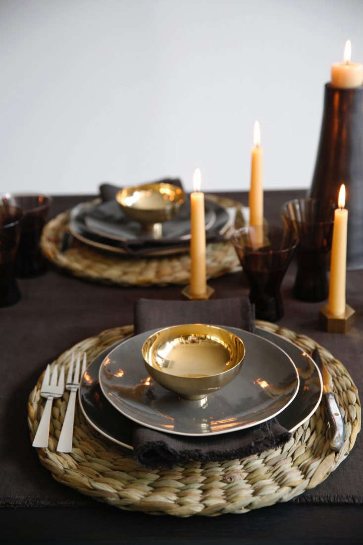Table jewelry: Perched atop each salad plate is aSmall Bowl by designer Ilse Crawford, made in Denmark of solid brass; $5.Tucked beneath is aBoxwood Linen Fringed Dinner Napkin to match the tablecloth; $55 each.