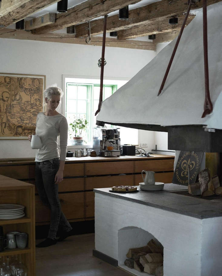 Expert Advice Nadine Redzepis Secrets to a WellOrdered Home Kitchen Nadine by the woodstove. Photograph by Ditte Isager.