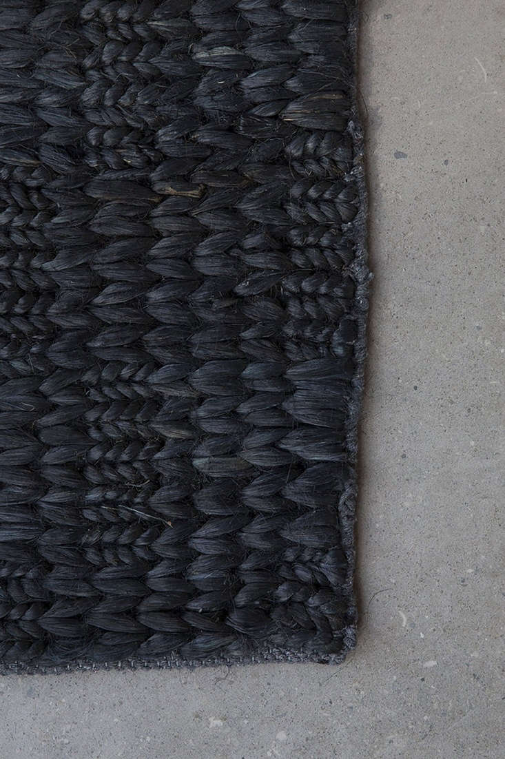 TheDouble Braid rug, made of brushed jute and available in black and natural, is currently on sale for more than 50 percent off: Prices start at $500 NZD ($34loading=