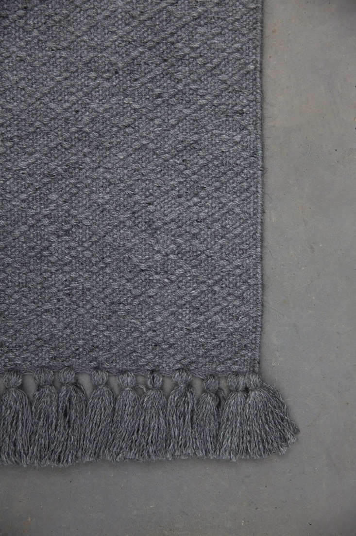 Thatch Weave is a sturdy wool and viscose blend available in three colors—charcoal (shown), light gray, and tan. The rug starts at $loading=