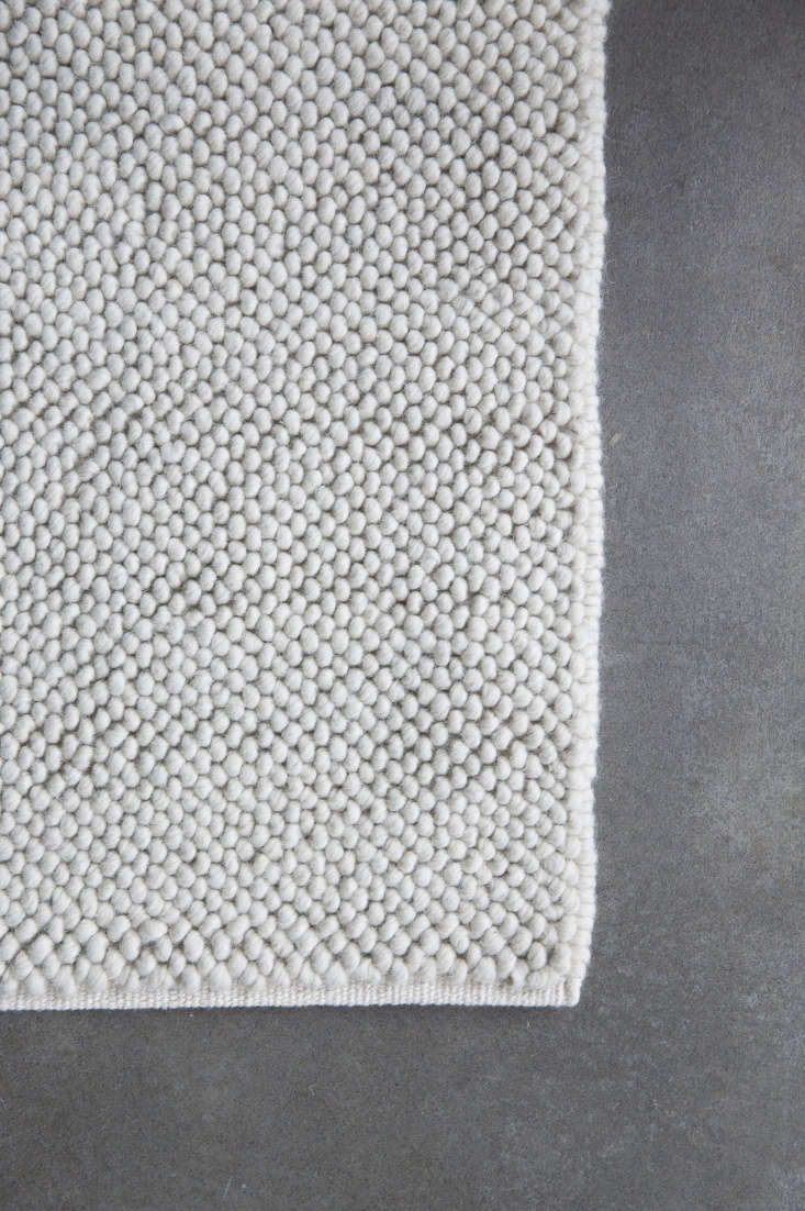 The Pebble Weave rug is a blend of wool and cotton, available in ivory (shown) and gray heather. Prices start at $loading=