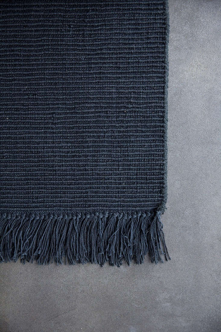 TheRibbed Jute rug in dark gray is made of 0 percent jute and is reversible. It&#8