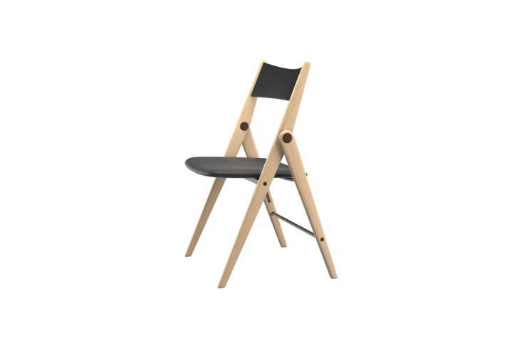 theoslo folding chair has a solid oak base with black leather seat and backre 10