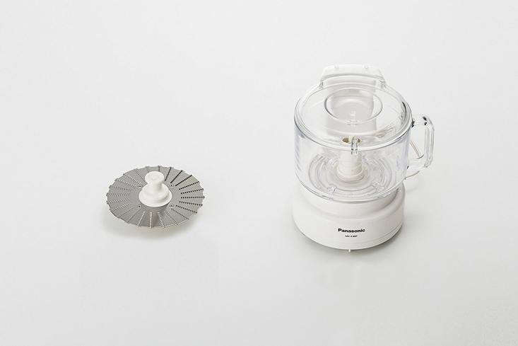 10 Easy Pieces Food Processors If you're game for a Japanese import, thePanasonic Food Processor has a glass container (with a \13 cup capacity) and comes with two types of cutters and a grater. You can get it on Amazon for \$\1\15.\14.