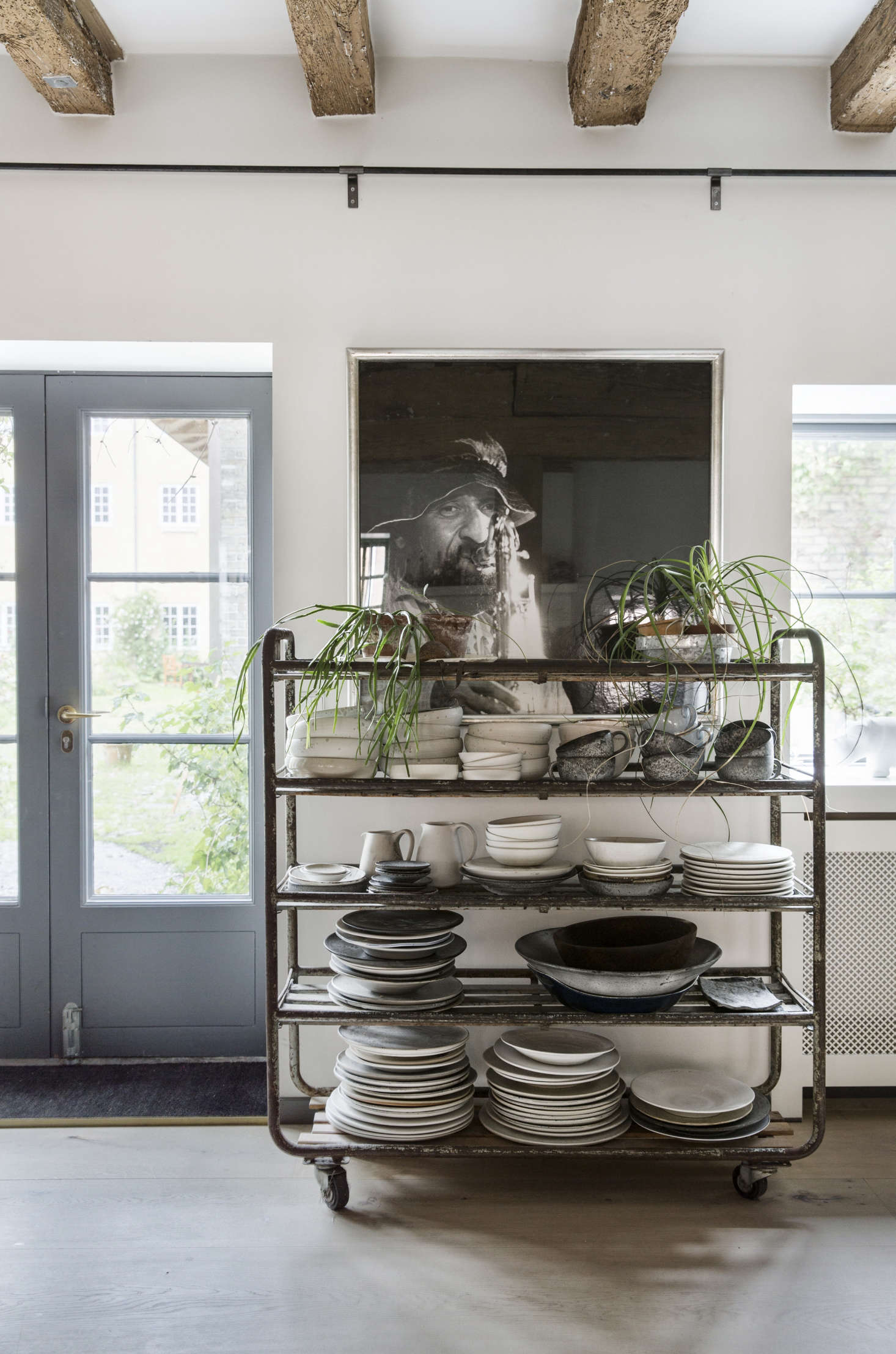 The elevated cart: Shelves on wheels keep everyday ceramics at the ready. Photograph courtesy of Dinesen.