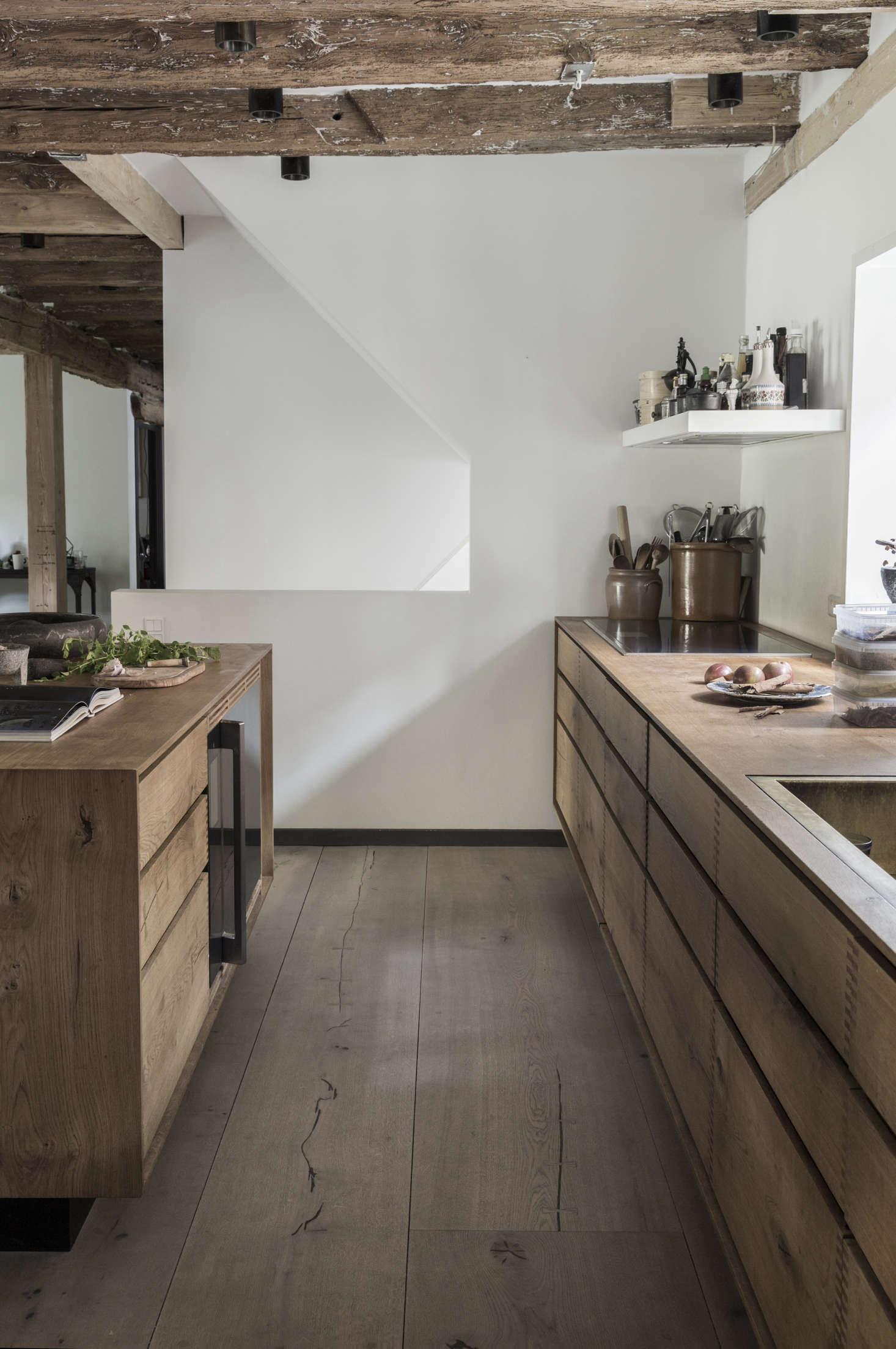 Cooking essentials are kept near the stove, including on the vent hood above. Photograph courtesy of Dinesen.
