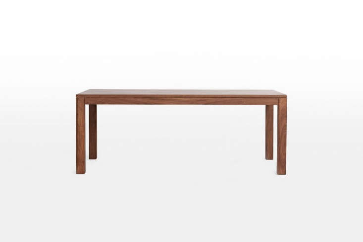 Available in walnut (shown) and White Oak, theLarge Crosby Table is $loading=
