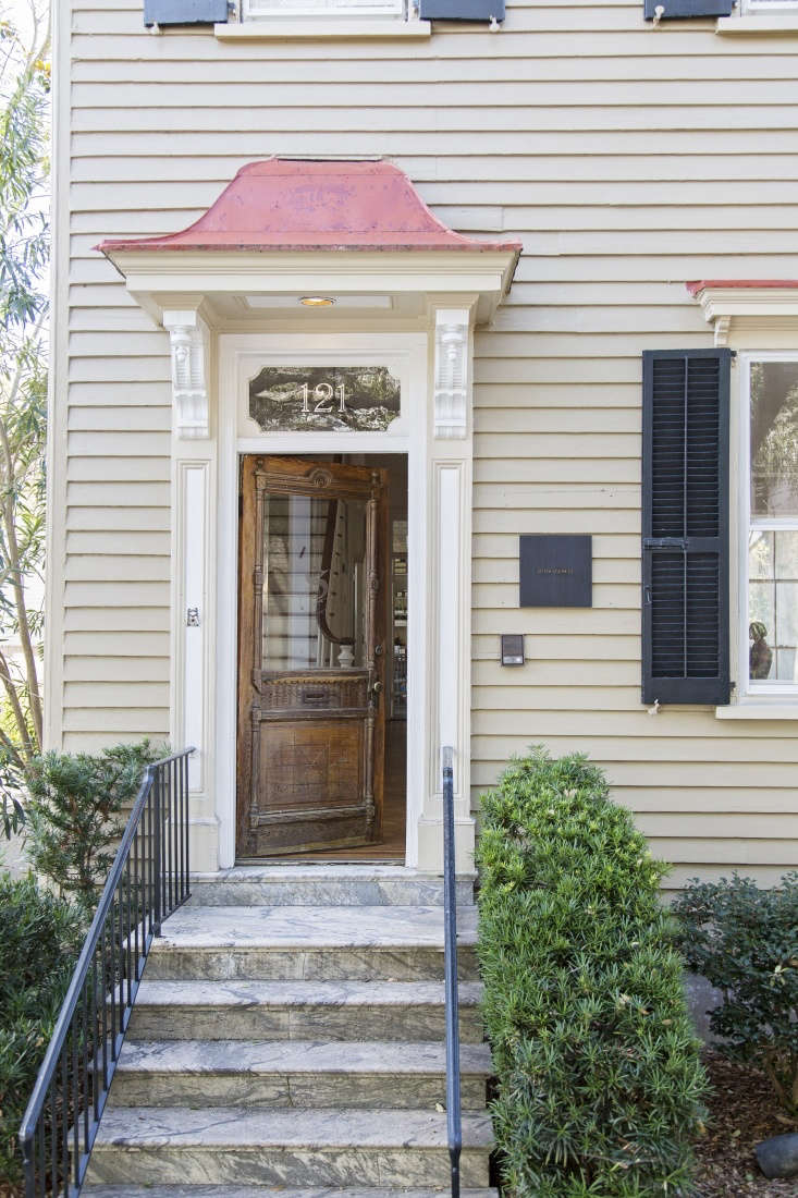 The striking entryway to the office, including the ornate front door and marble stairs, is all original: &#8