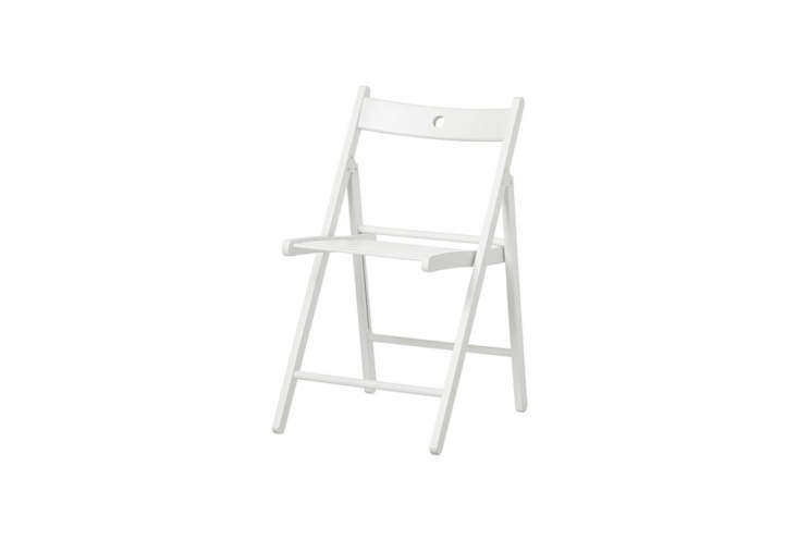 Julie and Francesca both keep a few of the small-profile, surprisingly sturdy Terje folding chairs on hand for entertaining; $.99.