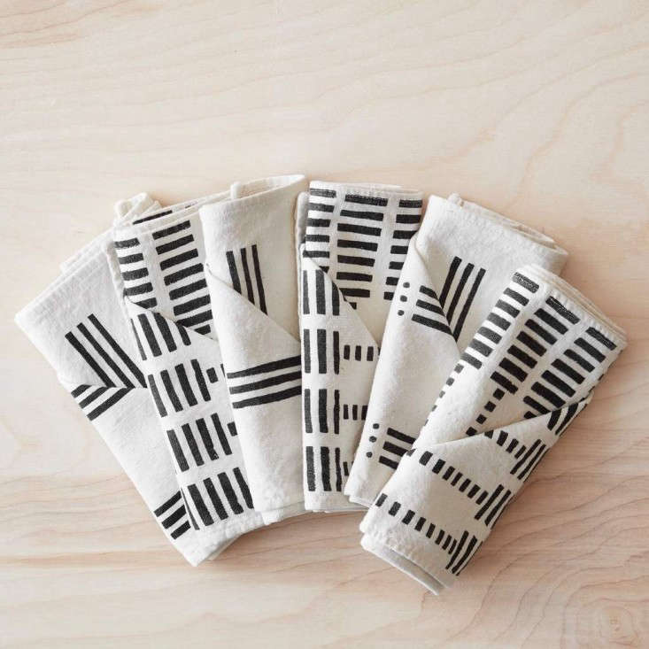 TheseEchelle Mud Cloth Napkins from Mali come in a set of six: two napkins in three different patterns, held together with a leather tie; $75.