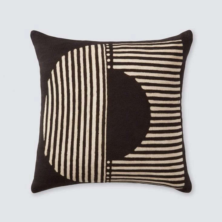 The Demi Mud Cloth Pillow, shown here in black, is also painted by hand in Mali and has the pattern on both sides. It&#8