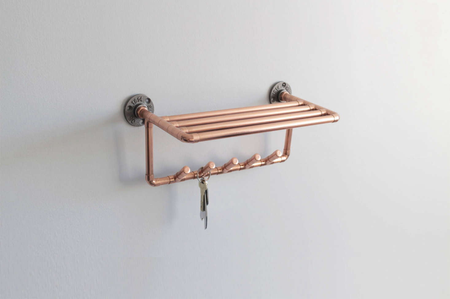 From the Copper Works on Etsy, the Copper Coat Hook Shelf is $60.69.