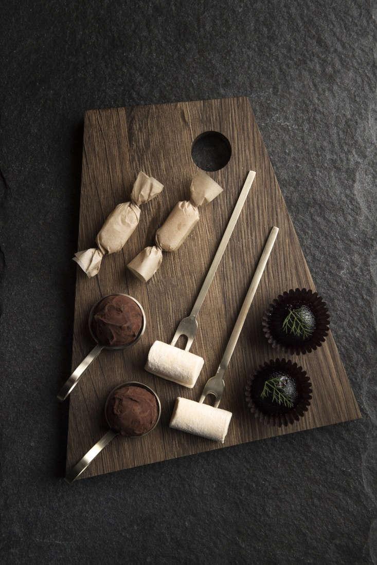 chocolates on an asymmetric cutting board. 13