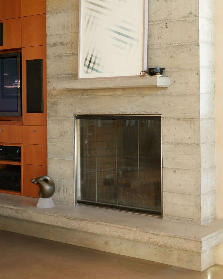 baker lane concrete front fireplace artwork singer