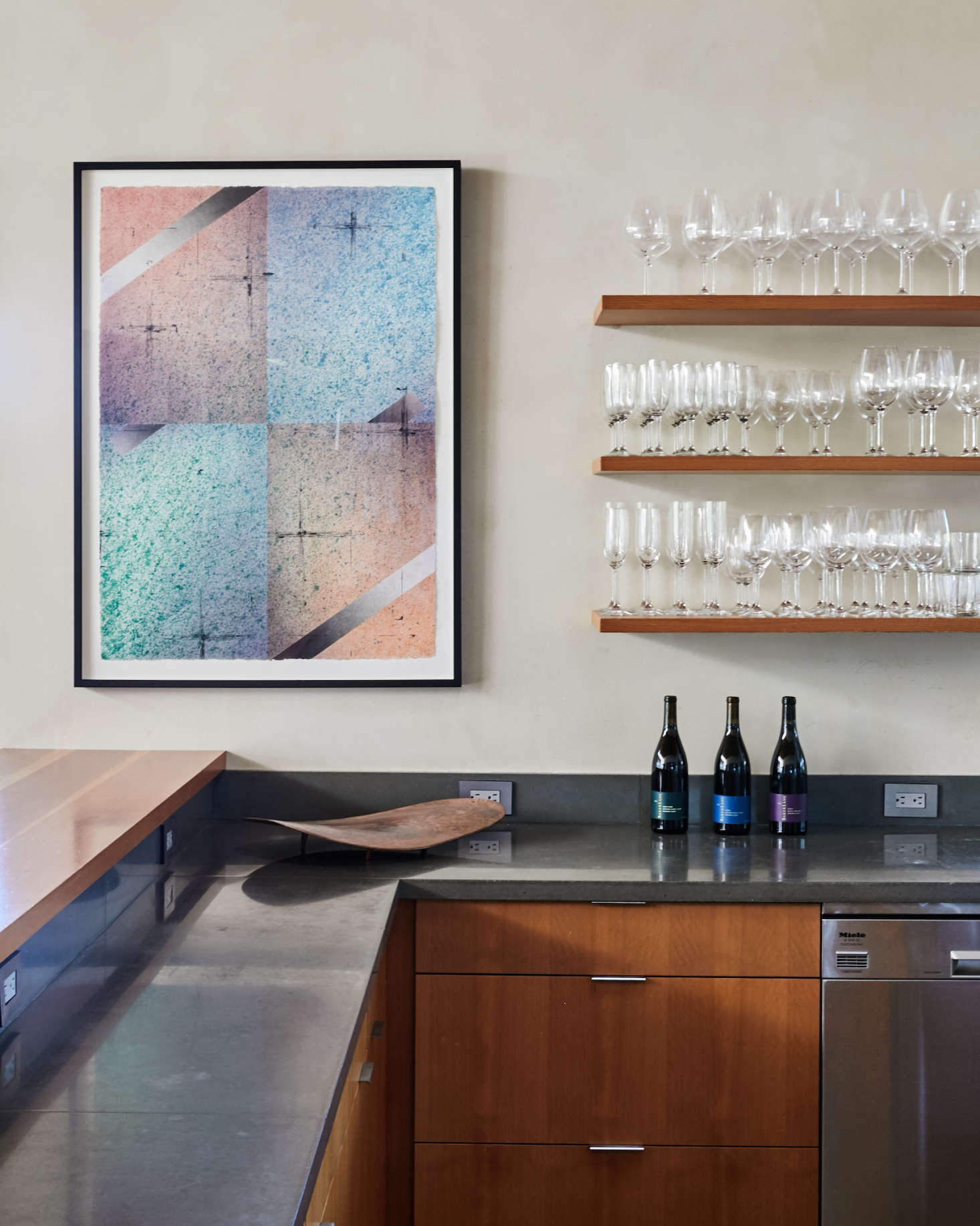 In addition to being a winemaker, Singer is a working artist (see his online portfolio here); the painting at the end of the kitchen is his.