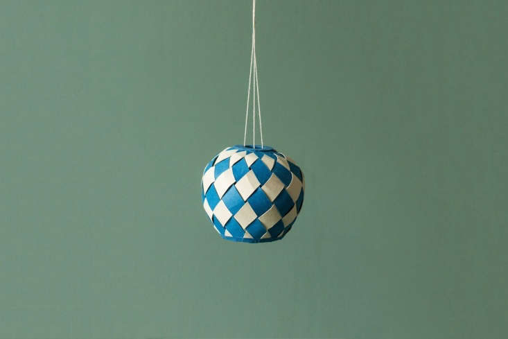 a paper lantern in woven hyancinth paper and cotton string by women artisans at 10