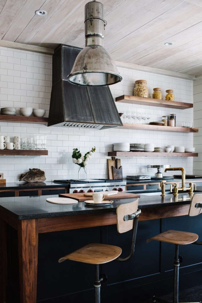 Kitchen countertops are black granite. The ceilings are pine boards washed in Behr&#8