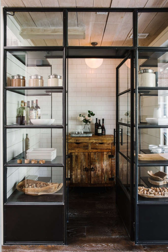 Inside the pantry is an antique sideboard and a handblown Globe Light—a custom Smith Hanes design (available on the studio&#8