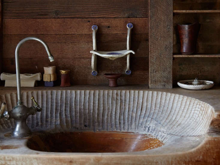 Blunk House Inside a Masters Sculptural Homestead Hewn by Hand in Northern California Blunk&#8\2\17;s hand hewn bathroom sink, with marks from his chisel.