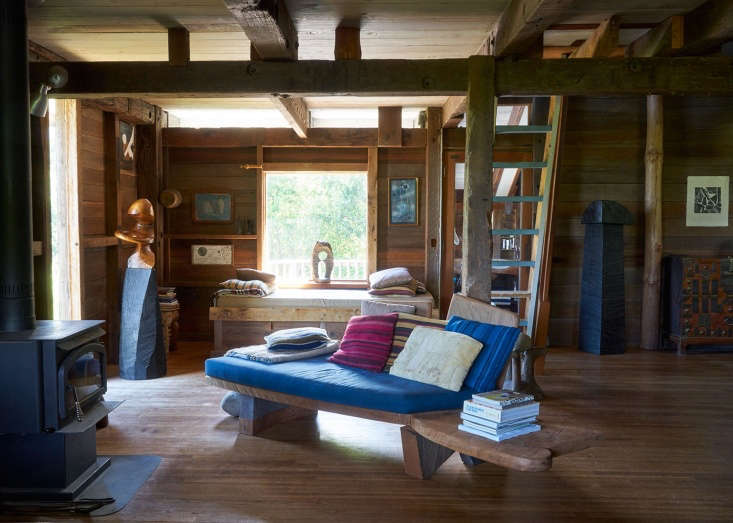 Blunk House Inside a Masters Sculptural Homestead Hewn by Hand in Northern California The open plan living space, with a carved, benchlike couch.