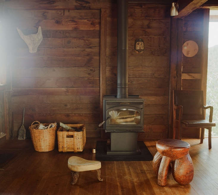 Blunk House Inside a Masters Sculptural Homestead Hewn by Hand in Northern California A woodstove heats the interior.