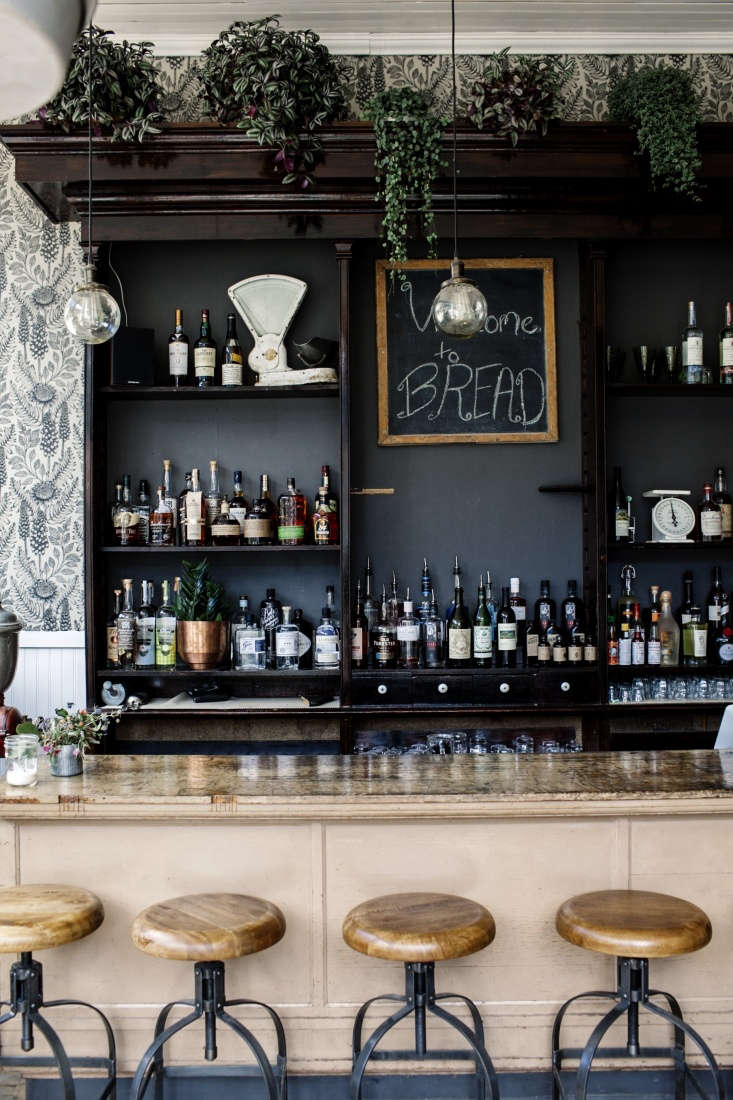 The original front bar; behind, black-painted shelves hold spirits. Photograph by Lauren DeFilippo.
