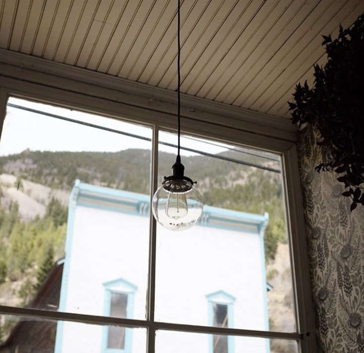 Delicate globe pendant lights hang along the bar. Photograph by @meggagnard.