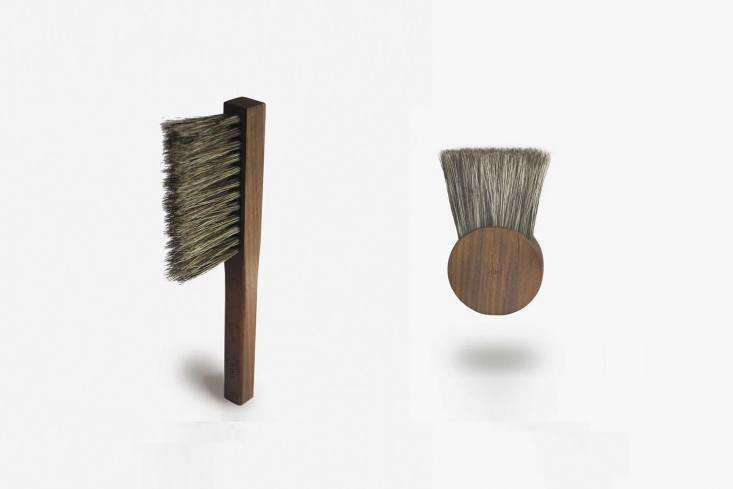 Two tidiness aids from British industrial designer Andrew Hine, both made of American black walnut and wild boar bristle; the ABRloading=