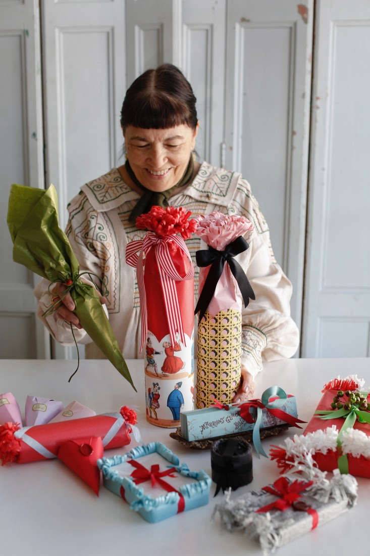 Claudia with a pile of freshly wrapped gifts, plus some classroom examples and items packaged just for the shop.