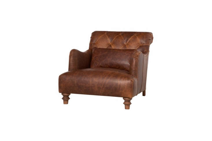 The Cisco Brothers Acacia Leather Chair has a .5-inch seat depth and is available in a range of leather upholstery. Contact Cisco Brothers for pricing and more information.