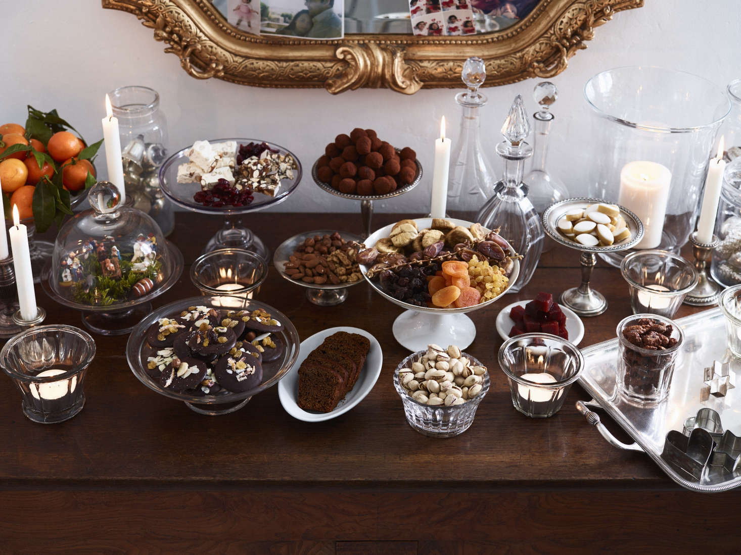 Do as the French do and let sumptuous bowls of food double as decor. Here—following the Provençal tradition of Thirteen Desserts—nuts, dried fruit, and sweets look elegant when displayed in mix-and-match cut glass and silver heirlooms. Photograph by Anson Smart from Christmas in Burgundy: At Home with the Expat Family Behind the Cook's Atelier.