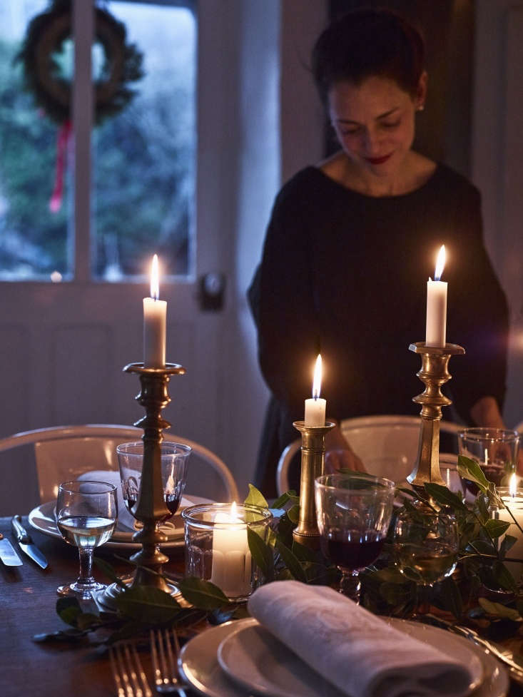 bay leaves from the garden and antique brass candlesticks decorate the table. 20