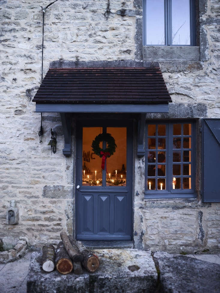 the couple left the old stone walls as is and painted the front door, windows,  25