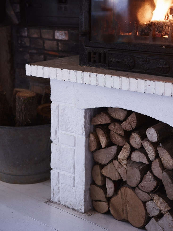wood neatly stacks in a brick niche under the fireplace. 16