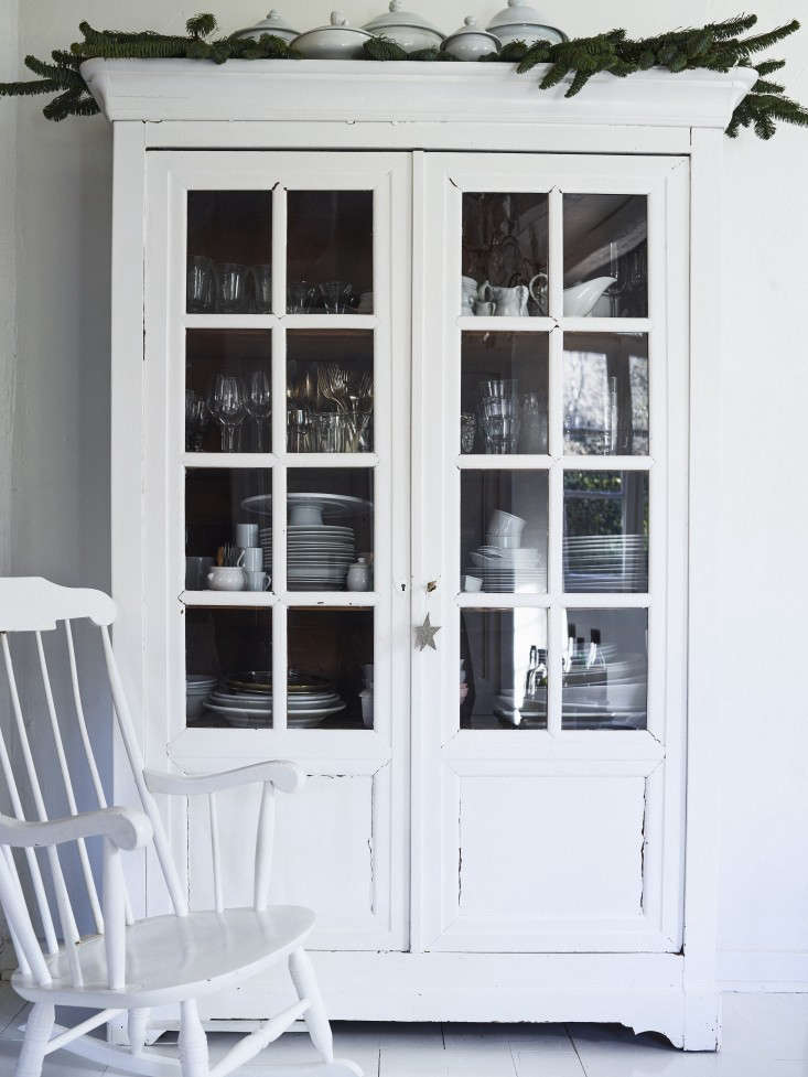 to brighten and unify the dining area, the couple painted the china cabinet and 17