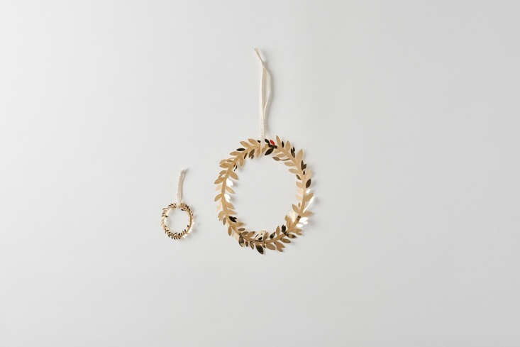 The Danish Gold Magnolia Leaf Wreath Ornaments by Spanish artist Helena Rohner is made of k-gold-plated brass; $30 to $65 at March.