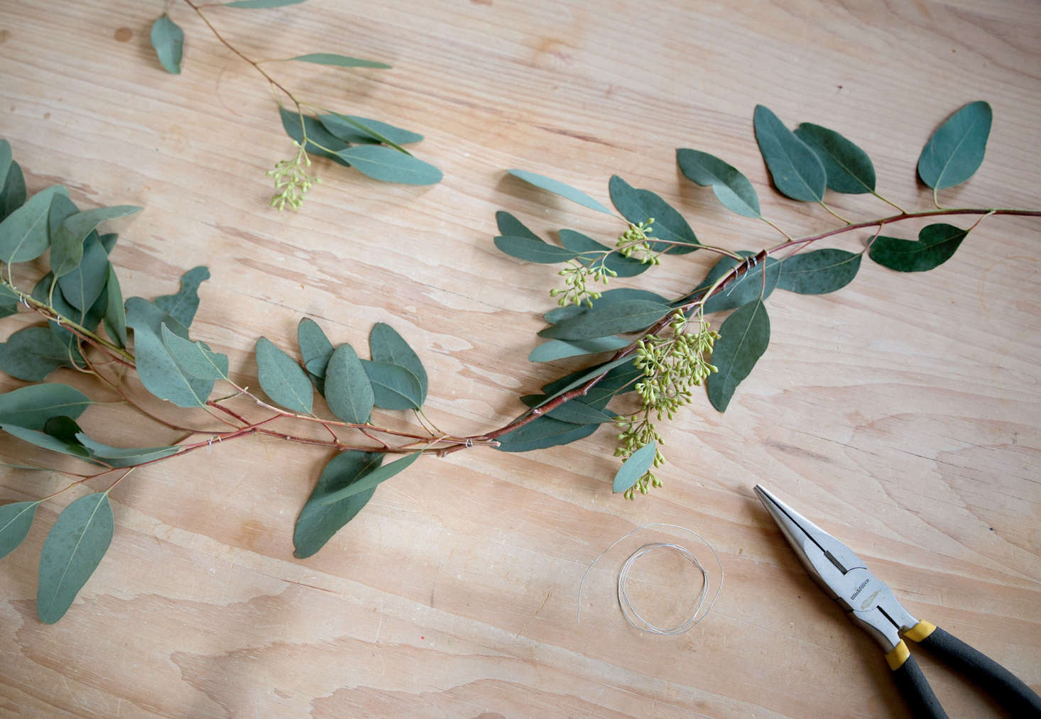 I have to admit, I picked up the $5 seeded eucalyptus branches from my local Whole Foods with the idea of incorporating them into a more lush display, but my minimalist tendencies won out. Holding up one branch, I noted its graceful curving bow and thought, &#8