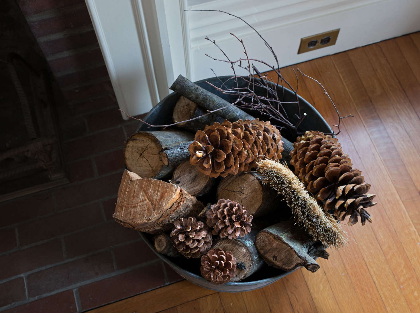 A vintage galvanized tub, which has always served as my log holder, received a holiday treatment with the addition of a few festive pinecones, foraged in Maine and California.