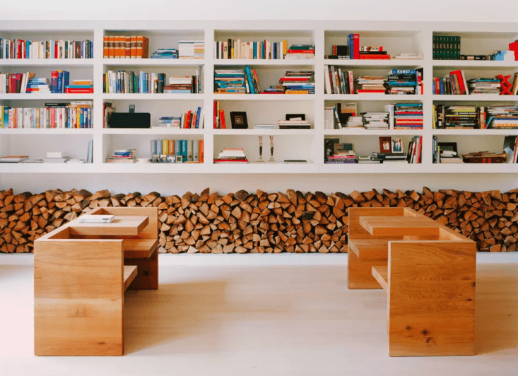a living room with e\15&#8\2\17;s tafel hp0\1 benches features a low wood p 18