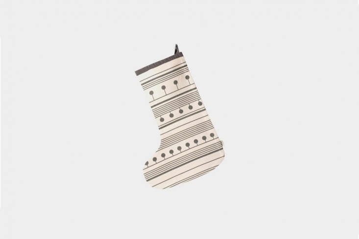 Another style from Ferm Living, the Winterland Christmas Stocking comes in gray (shown), black, and pale pink; €30 ($35) at Ferm Living.