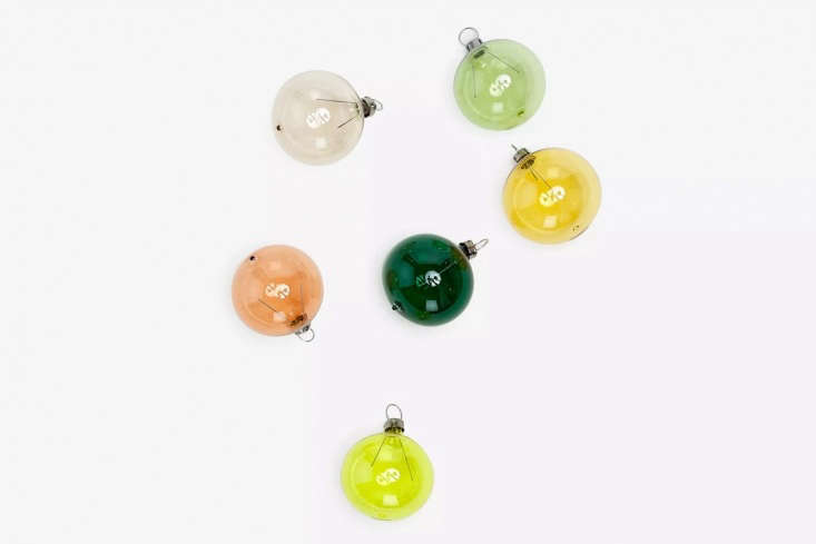 The Green Spectrum Ornament Set is made in Germany of hand-painted mouth-blown glass globes; $ for a set of six at ABC Carpet & Home. Also available is the Pink Spectrum Ornament Set for the same price.