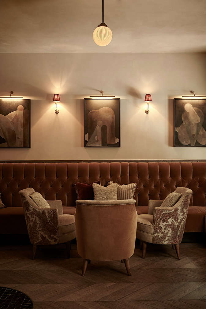 A sumptuous area for lounging, in hushed warm velvets that evoke a theater curtain.